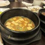 36816584 - この日の定食の汁物は2つ、一品目はピリ辛の豆腐チゲです