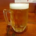 カタコト - お店の定番ビールシンガポールの魂「タイガービール」