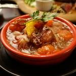 肉バル NORICHANG - ヤリイカとトマトのアヒージョ・・チョット仕様を変更したみたい。
