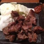 37520935 - 豚肉のこめかみ。食感がおもしろいです。