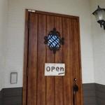 ポム - お店のドア