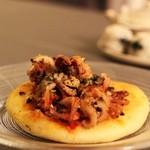 オリミネベーカーズ - 料理写真:イイダコのフォカッチャ ブッタネスカソース味なんです さすが築地@@