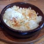 38291366 - リゾ飯(小:180円)ラーメンの残りスープに投入していただきます