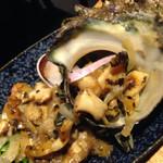 魚真 - サザエのバター焼き