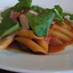 38433373 - ズッキーニのトマトソース、生ハムとリコッタチーズをのせたペンネ