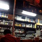 やきとり ふくちゃん - 店内には地元焼酎を含めいろいろな焼酎が並んでいます。