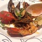38930947 - 新鮮な魚介類とフレッシュトマトソース〜イカスミを練り込んだ自家製タリオリーニ〜