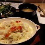 38989843 - シーフドとミニトマトの焼きチーズドリア