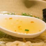 39062725 - 「隼人の塩」黒さつま鶏スープと帆立の貝柱を使い、黄金色をした和風スープ
