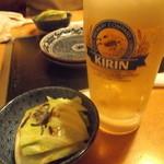 39264352 - 生ビールとお通しのキャベツ
