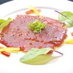 南蛮食堂 Nan Boon - まぐろのカルパッチョ♪980円 おなじみイタリア風お刺身をトマト風味のソースでさっぱりとマリネ風に♪