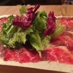 黒毛和牛一頭買い肉バル デルソーレ - お通しの和牛生ハムはやっぱり贅沢!