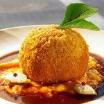 美味卵家 - オレンジ仕立てのリゾットライス。コロッケの中には松のみ、とろけるチーズが入っています