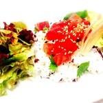 アーヴィルカフェ - 料理写真:カリカリ食感のうめご飯にアボガドとづけまぐろをのせました。胡麻だれをかけてお召し上がりください。