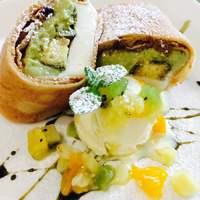 イシガキ ユーグレナガーデン - 【ISHIGAKI生ポーポー】石垣島の伝統的な郷土菓子ポーポーの中に、ババロア、スポンジケーキ、ユーグレナ・カスタードクリーム、ユーグレナ・チョコレートを入れて包みました。