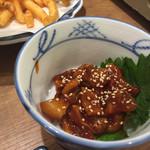 磯丸水産 - ツブ貝のチャンジャ
