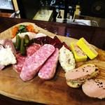 a table - 自家製シャルキュトリー お肉の前菜盛り合わせ