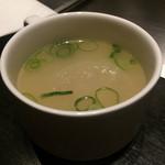 41062998 - お通しは鶏ガラに大根と薩摩揚げが入ったおでんのようなスープ♪¥400-@2015.8.20訪問