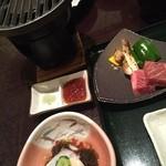 41091839 - 魚介類のもずく添え、向こう側は焼く前のお肉と松茸