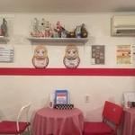 41179560 - 店内はマトリョーシカを前面に出した可愛らし気な雰囲気。