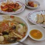 餃子の王将 - 食べかけ(((^^;)酢豚と、餃子