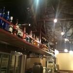 41418083 - カウンター上には、洋酒のボトルがずらりと並んでいます