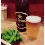 かおる - 瓶ビール520円とお通しの枝豆