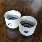 徳蔵Cafe - お水も大きめのお猪口ででるのが嬉しいです