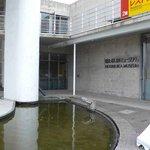 光彩 - 左手がホタルイカミュージアムの入口です。右手がパノラマレストラン光彩です。一部赤と黄色の看板が写っていますね。