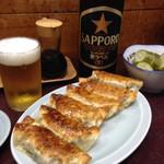 三祐 - 大瓶ビールと餃子で¥750★