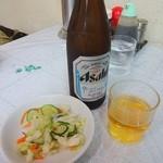 黄河楼 - 瓶ビールとサービスの漬物
