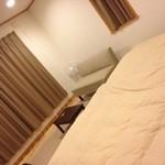 ノーザンロッジカント - 13畳の洋室にセミダブルベットのツインルーム