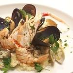 イタリア食堂 ジラソーレ - たっぷり魚介のリゾット