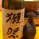 牡蠣と日本酒 四喜 - 獺祭 純米大吟醸磨き二割三分