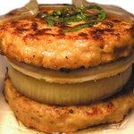 食事処 まるやま - 料理写真:肉ではさんだ逆バーガーです。ソースは地元の由仁商業高校が開発した愛郷ドレッシングを使っています。