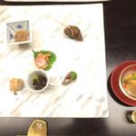 43378117 - 先附け                       サーモン、雲丹、蓴菜のバルサミコゼリー掛け                                              前菜                       名代烏賊の塩辛                       もずくの自家漬け                       宮城産活蛸の当座煮                                                                     蛸ではなく、お魚に変更されておりました。                       他にバイ貝など。                                              食前酒は梅酒でした。