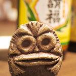 風亭 - シーサーは作者に顔が似ると言われている。