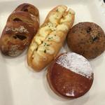 44727414 - 左から、リンゴとくるみのフランスパン、明太フランス、クイニーアマンみたいなパン、黒ごまフランスパンのあんぱん