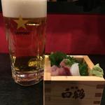炭蔵 - お通し 280円・生ビール(サッポロ 黒ラベル)499円。