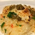 ピッツェリアアッセ - ズワイガニとカニ味噌の焼きリゾット  温度卵のせ