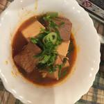風月 - 突き出しの豆腐の煮込み