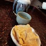 46512942 - お酒(古都千年)とお通しの蕎麦煎餅