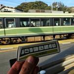 46522063 - 走行する江ノ電とツーショット