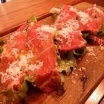 46732103 - Antipasto(前菜)の一皿目は「熊本赤牛のカルパッチョ」です。