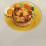 47068590 - オマール海老入り帆立貝のスフレ サフラン風味のソース