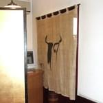 飛騨牛かわい - 1階席の入口暖簾です。