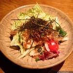 旬の鮮魚と魂の煮込み 照 - 「荒木豆腐と煮ジャコサラダ」です。