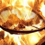 もつ鍋・百日鶏 一期一会  - 料理写真:百日鶏もも炭火黒焼き