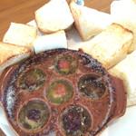 47563122 - タコのエスカルゴ風バター焼きパン付き                       パンがソースに良く合い美味しい