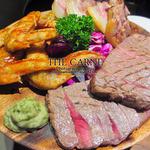47621565 - カルネ人気No.1を誇るコスパ最強メニュー                       肉の盛り合わせ